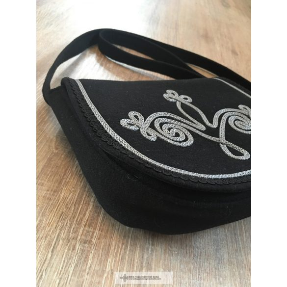 Black women's bag with black decorations, pearls.